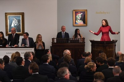 Helena Newman, Chairman of Sotheby's Europe, fields bids during the Impressionist & Modern Art Evening sale in London on 28 February 2018  - part of a two week series of auctions that raised more than $430 million and saw Pablo Picasso's portrait of Marie-Thérèse Walter sell for nearly $70 million.