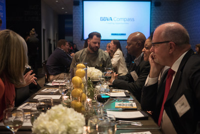 Café Momentum founder Chad Houser with BBVA Compass guests Thursday night at his restaurant in Dallas, where the bank gathered to celebrate his first-place prize of $50,000 in the BBVA Momentum training and accelerator program for social entrepreneurs.