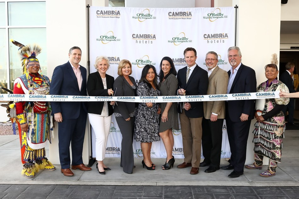 Executives from Choice Hotels and O'Reilly Hospitality Management celebrate the grand opening of the Cambria Hotel North Scottsdale Desert Ridge with a ribbon cutting ceremony.