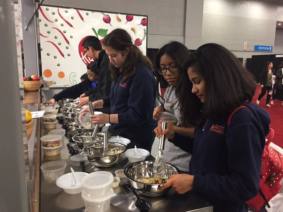 Students at SXSW EDU cooking up change by making Aztec Quinoa Grain Bowls at Elly, Chartwells K12's Mobile Teaching Kitchen.