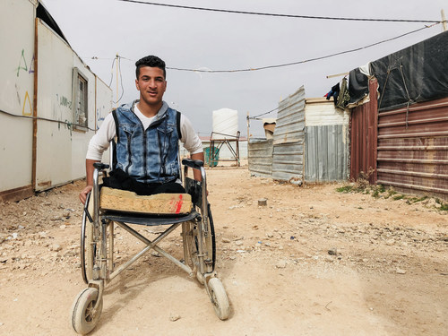 """Sami (14), originally from Dera'a in southern Syria, is now a refugee in Jordan. He says, """"I went outside to play in the snow with my cousins. A bomb hit. I saw my cousin's hands flying in front of me. I lost both my legs. Two of my cousins died and one also lost his legs."""" ©UNICEF (CNW Group/UNICEF Canada)"""