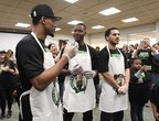 Marcus Smart, Terry Rozier and Shane Larkin making healthy smoothies with YMCA kids for the Sun Life Fit to Win program.