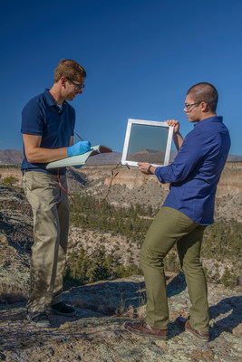 UbiQD team members measure the electrical output of a window prototype a short walk from the company's headquarters in Los Alamos, NM. Credit: UbiQD, Inc.