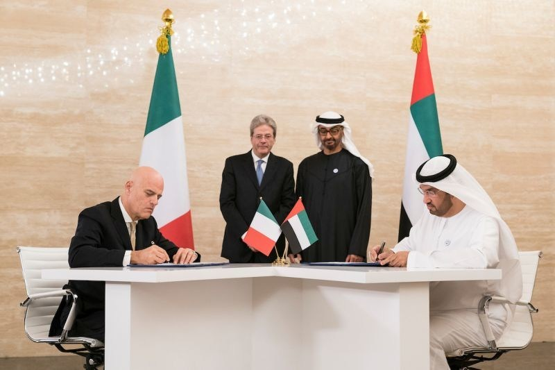 Dr. Sultan Ahmed Al Jaber (front R), ADNOC Group CEO, and Claudio Descalzi (front L), CEO of Eni, sign historic agreements awarding Eni stakes in two of Abu Dhabi's offshore concessions, witnessed by H.H. Sheikh Mohamed bin Zayed Al Nahyan, Crown Prince of Abu Dhabi and Deputy Supreme Commander of the UAE Armed Forces (back center R), and H.E. Paolo Gentiloni, Prime Minister of Italy (back center L). (PRNewsfoto/Abu Dhabi National Oil Company)