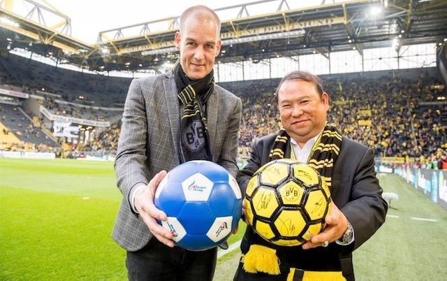 BVB's CMO - Carsten Cramer and Bangkok Airways President - Puttipong Prasarttong-Osoth at Signal Iduna Park in Dortmund, Germany.