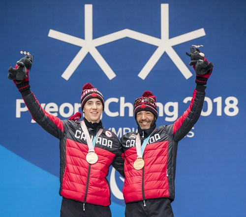 Brian McKeever (right) with guide Graham Nishikawa (left) now holds the most medals of any Canadian Winter Paralympian following his victory in the 20KM cross-country ski race on Monday. PHOTO: CANADIAN PARALYMPIC COMMITTEE (CNW Group/Canadian Paralympic Committee (Sponsorships))