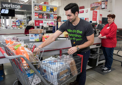 An Instacart employee checks out at BJ's Wholesale Club in Waltham, Mass. on March 13, 2018 for same-day delivery to BJ's members as part of the companies' expanded partnership. (BJ's Wholesale Club/Christine Hochkeppel)