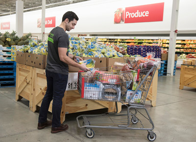 An Instacart employee selects fresh produce at BJ's Wholesale Club in Waltham, Mass. on March 13, 2018 for same-day delivery to BJ's members as part of the companies' expanded partnership. (BJ's Wholesale Club/Christine Hochkeppel)