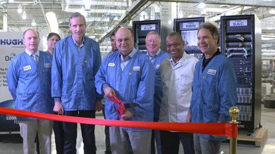 Greg Wyler visits Hughes executives at Hughes manufacturing facility in Gaithersburg, MD for first gateway shipment.