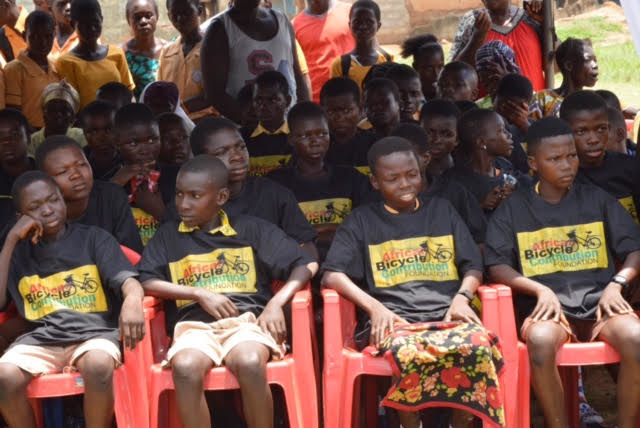 Students from Ejisu-Juabeng School, in the Ashanti Region of Ghana sit prior to a well-attended ceremony in which they received free EcoRide bamboo bikes funded by the African Bicycle Contribution Foundation.