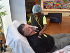 """Dr. Mark Mogul, medical director of pediatric hematology/oncology at St. Joseph's Children's Hospital in Tampa, gets a checkup from 11-year-old D'lany Harrigan during the hospital's annual """"Doctors for a Day"""" event March 14, 2018."""