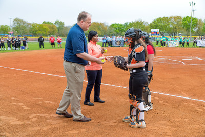 LyondellBasell's La Porte site manager Chris Cain and Marian Harper, vice president of development for the Astros Foundation, marked the completion of enhancements to four youth softball fields by participating in the ceremonial first pitch at the La Porte Girls Softball Association's Opening Day ceremony.