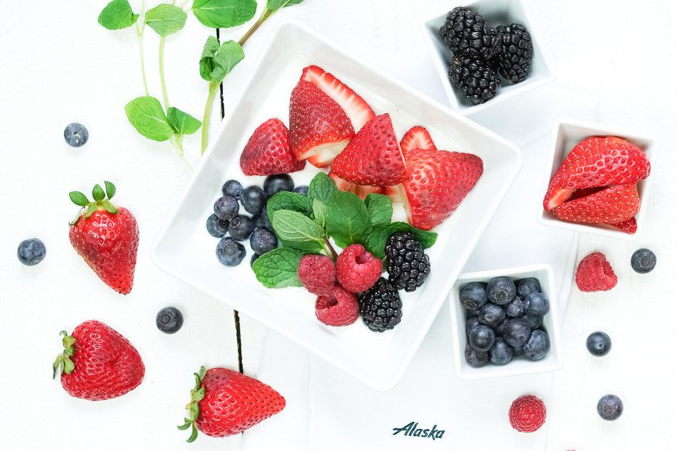 A flavorful new First Class menu will start flying this week on Alaska Airlines, including the Greek Yogurt with Berries. Honey-infused Greek yogurt with fresh strawberries, blueberries, raspberries, and blackberries.