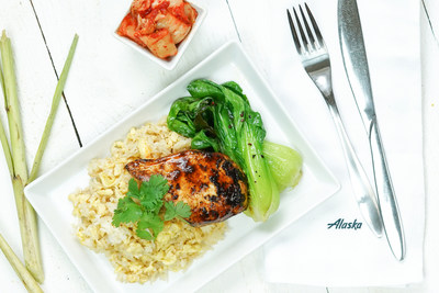 Alaska Airlines unveiled a flavorful new First Class menu inspired by the West Coast food scene. The Lemongrass Chicken is a boneless chicken breast marinated in lemongrass, shallots, soy sauce, and ginger. Served with mushroom fried rice, baby bok choy, and a kimchi aioli. Garnished with fresh radish sprouts.
