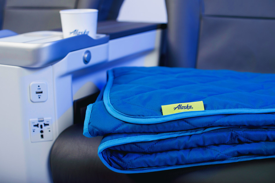 It's the little extras of First Class that make all the difference. Alaska Airlines is adding cozy quilted throws on longer flights to keep you comfy.