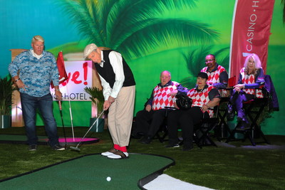 """The excitement and pressure were on at Live! Casino & Hotel Thursday night as professional golfer John Daly took on David Cordish, Chairman of The Cordish Companies, in a head-to-head golf challenge. The 'David vs. Daly' showdown ended in a one-stroke victory for the """"Wild Thing"""" as John Daly sunk a hole-in-one on the third and final green."""