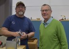 Ernie Hamm, machinist, is shown with Peter Feil, general manager.