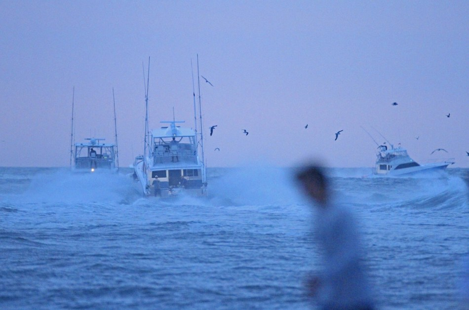 Boats depart the Ocean City, MD Inlet for the 2017 White Marlin Open Tournament. Image Credit: Hooked On OC