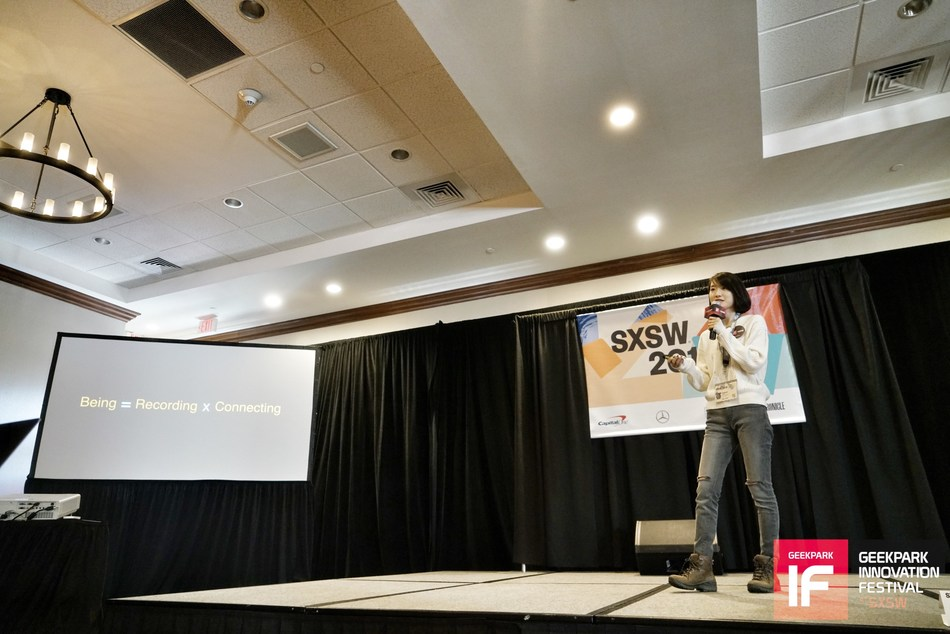 A representative from Kuaishou explains values of Kuaishou at SXSW on March 14, 2018