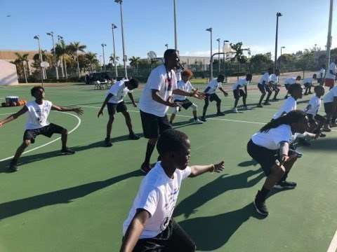 Jayson Williams teaches basketball skills at the Jayson Williams and Charles Oakley Free Basketball Camp in South Florida