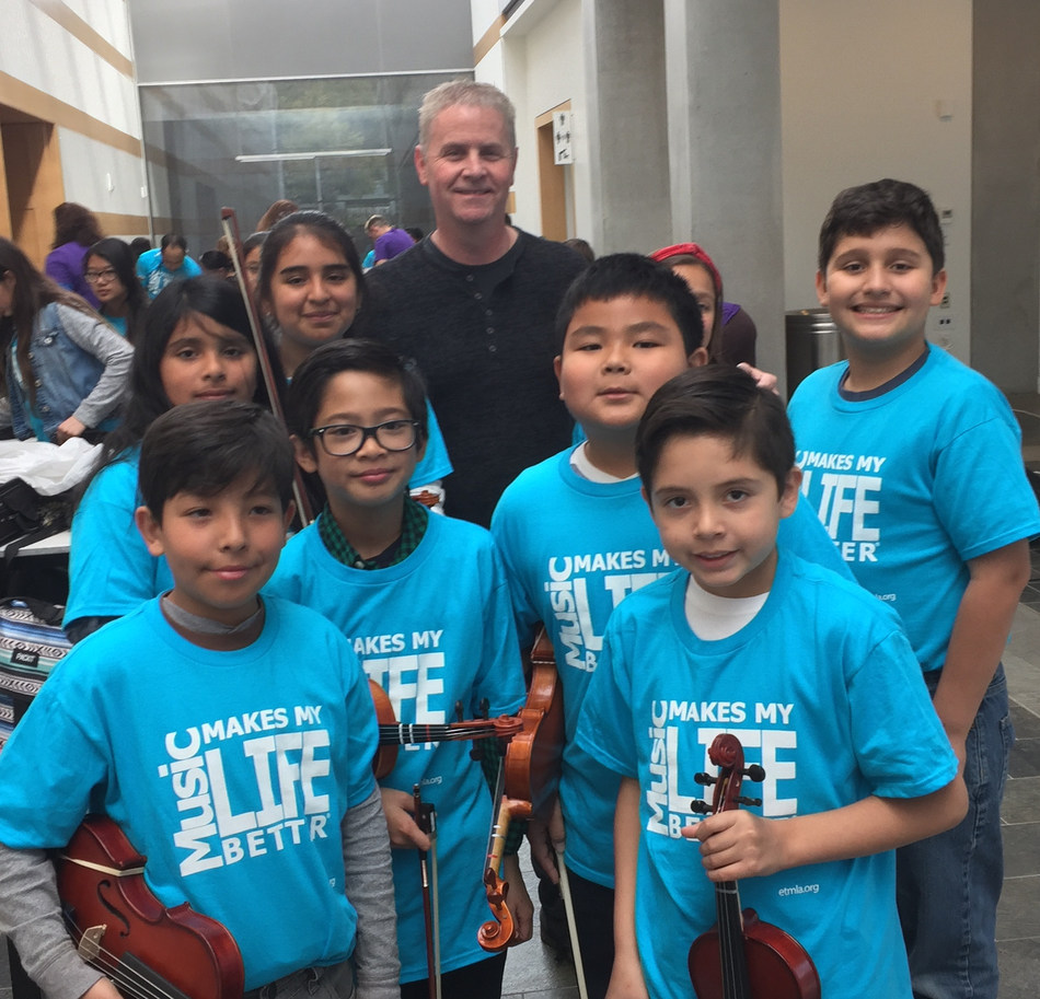 Students meet Composer Blake Neely (Flash, Arrow, Kevin Probably Saves the World) before taking the stage at the Education Through Music-Los Angeles 8th Annual Music Unites the World Festival, March 15, 2018, Skirball Cultural Center. www.etmla.org Photo Credit: Victoria Lanier / ETM-LA