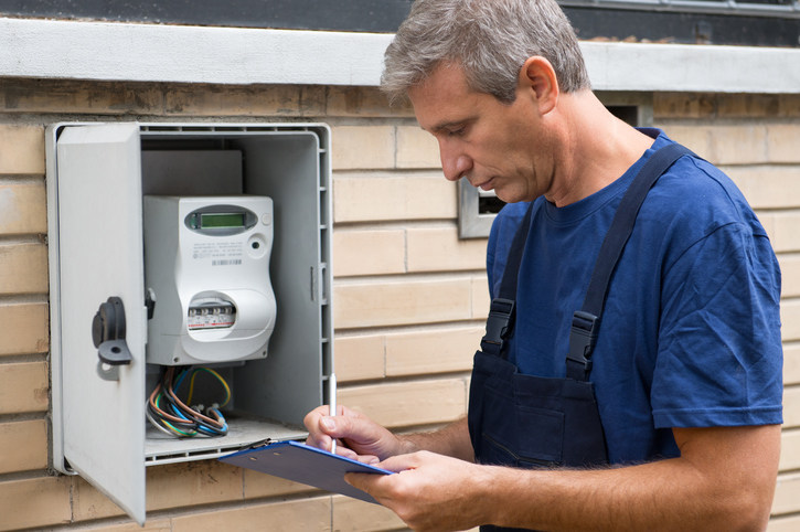 Utility employee setting up new utilities for a relocation client.