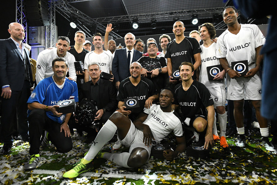 Group photo of both teams after the football match of friendship during Baselworld in Basel, Switzerland, on March 21, 2018. Hublot assembles Usain Bolt, Jamaican former sprinter, Diego Maradona, former Argentinian football player and Jose Mourinho, Portuguese football coach on the pitch. (PRNewsfoto/Hublot)