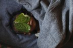 Damir Sagolj: Bangladesh Leaves cover the eyes of 11 month old Rohingye refugee Abdul Aziz after his body was brought back to family shelter at Balukhali refugee camp near Cox's Bazar, Bangladesh few hours after he died December 4, 2017. Adbul Aziz, whose family fled Myanmar some two months ago, died at local clinic after suffering from high fever and severe cough for ten days, his mother said. (PRNewsfoto/Anadolu Agency)