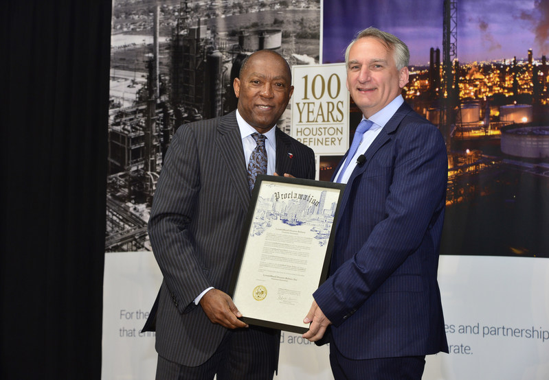 """Houston Mayor Sylvester Turner presents LyondellBasell's Houston Refinery Site Manager Jerome Mauvigney, with a proclamation declaring March 22nd """"LyondellBasell Houston Refinery Day,"""" in celebration of the Refinery's 100th anniversary."""
