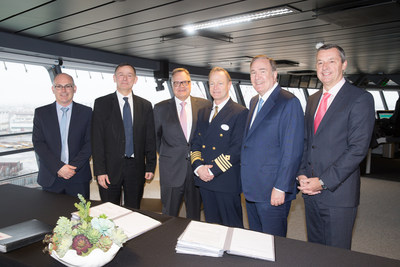 Royal Caribbean International takes delivery of Symphony of the Seas at a signing ceremony on the bridge overlooking the shipyard in Saint-Nazaire, France. The formalities were followed by a celebration of the 4,300 shipbuilders and crew who built the world's largest cruise ship. Left to right: Jean-Yves Jaouen, COO, and Laurent Castaing, General Manager, STX France; Richard D. Fain, Chairman & CEO, Royal Caribbean Cruises Ltd.; Michael Bayley, President & CEO, Royal Caribbean International.