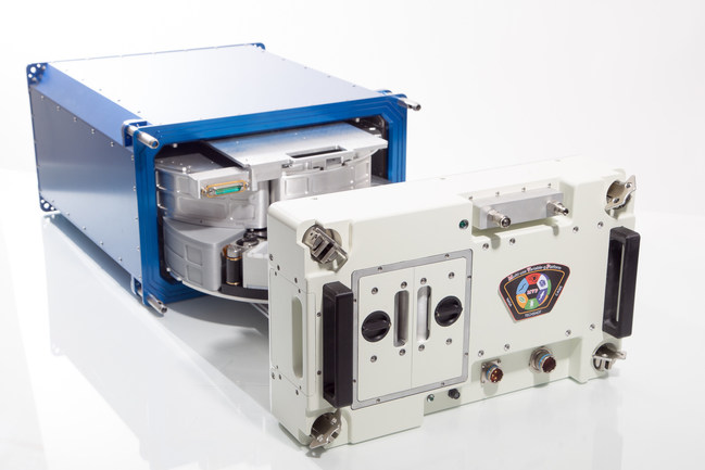 Seen with its door removed, revealing two carousels, the Techshot Multi-use Variable-g Platform (MVP) is a privately owned and operated research system for the International Space Station. It is used for studies in space with fruit flies, plants, aquatic animals, flatworms, protein crystals, cells and many other sample types. Each carousel can produce from 0.1 to 2.0 g of artificial gravity.