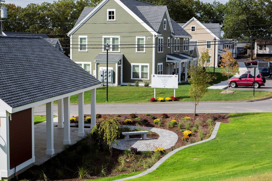 The revitalized Davis Gardens (left), a 60 year-old affordable housing community in Waterbury, Connecticut, qualified for a portion of Boston Community Capital's previous Capital Magnet Fund Award.  Photo credit: Marilyn Humphries