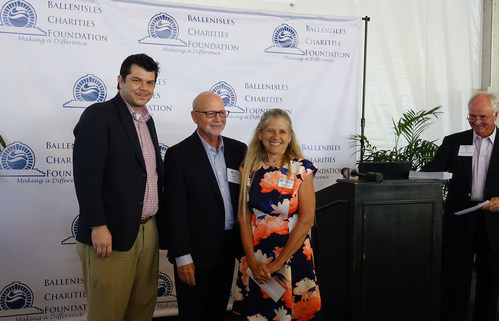 BallenIsles Charities Foundation sets another fundraising record – awarding more than Half-a-Million Dollars in Financial Grants to local charities.   Pictured: Alzheimers Community Cares-Jonathan Price, VP Grants, Dianne Bruce, Director of Grants with BICF President Mark Freeman (center). Bob Anton, Chair of the BICF Grants Committee stands at Podium. The BallenIsles Charities Foundation Grant provides funding for Alzheimers Community Cares Family Nurse Program.