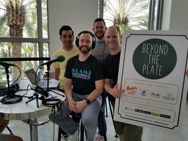"""Beyond the Plate"" consists of interviews where Andrew ""Kappy"" Kaplan sits down in person with the world's culinary elite to explore their journey as well as the social impact chefs have made in their community. Kappy (front) has created a dynamic production team for this podcast project using the talents of his associates, Shant Petrossian (left), Ian Cohen (right), and Joel Yeaton (center back), who have worked with him through the years in the food TV industry."