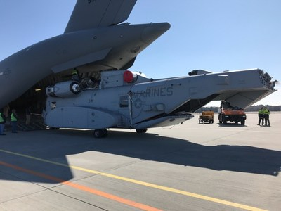A Sikorsky CH-53K heavy lift helicopter was unloaded from the cargo bay of a C-17 Globemaster, which touched down in Holzdorf, Germany, ahead of its international debut at the ILA Berlin Air Show next month. Photo courtesy Sikorsky, a Lockheed Martin company.