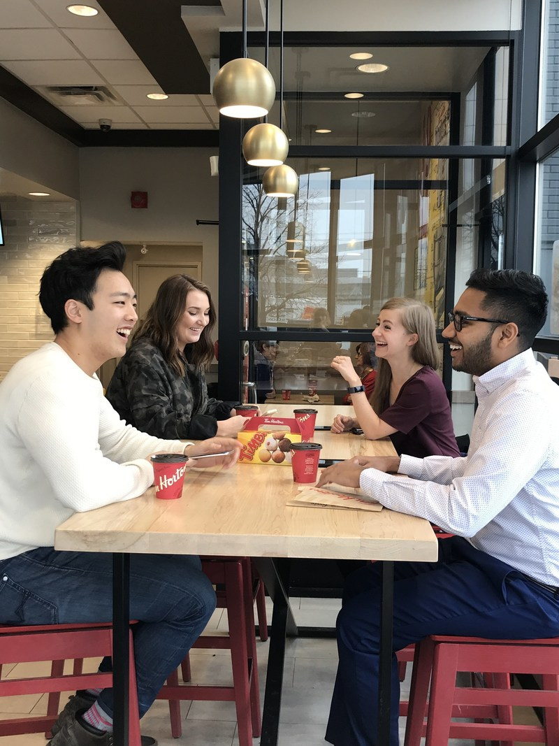 New high tables encourage our Guests to enjoy their favourite cup of coffee with their friends. (CNW Group/Tim Hortons)