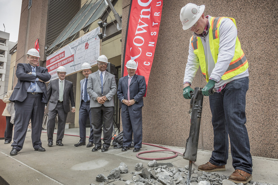 McCownGordon Construction's Chris Hampton operated a jackhammer to break ground on the firm's renovation of 850 Main in downtown Kansas City, MO. When complete in early 2019, the building will house the growing construction management firm. Looking on (l to r) is City Manager Troy Schulte, KCEDC president Bob Langenkamp, McCownGordon chief executive Ramin Cherafat, Jackson County Executive Frank White and McCownGordon chairman of the board, Brett Gordon.
