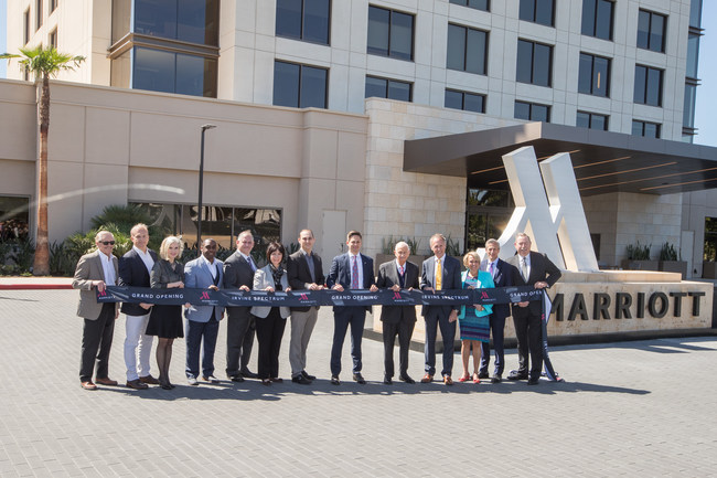 Grand Opening celebrations at the Marriott Irvine Spectrum with J.W. Marriott Jr., Chairman of the Board of Marriott International, Chris Harrison, General Manager of the Marriott Irvine Spectrum, Robert Olson, President and CEO of RD Olson Development, and other executives in Irvine, Calif., on March 27, 2018. (Jeff Lewis/ AP Images for Marriott Hotels)