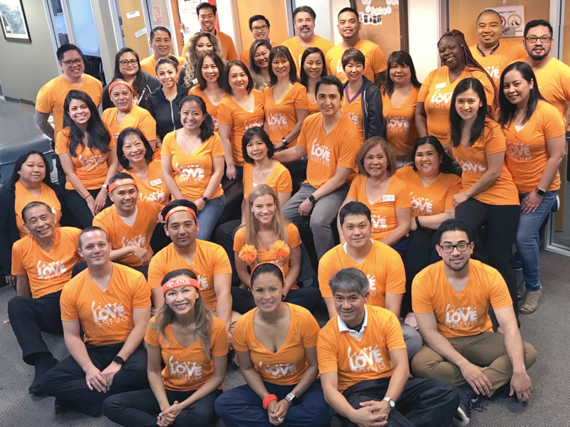 ANX Family Photo brandishing our company battle cry: Live, Love, Serve. Live with Passion, Love Unconditionally, and Serve with Purpose.