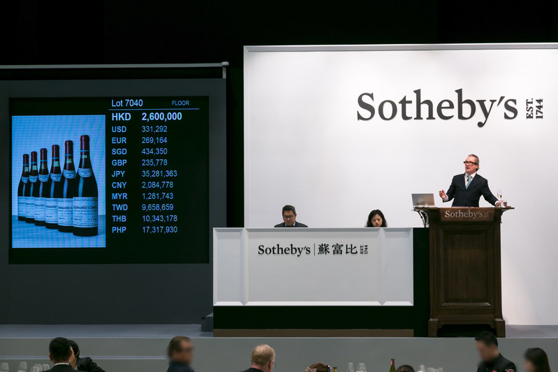 Sotheby's auctioneer Jamie Ritchie sells the top lot of the sales, 12 bottles of 1971 Domaine de la Romanée-Conti HK$3,198,000 / US$407,489