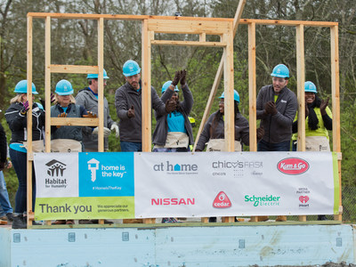 Drew and Jonathan Scott help future homeowners Ashlee and Amanda raise the walls of their new homes in Nashville as part of Habitat for Humanity's national Home is the Key campaign.