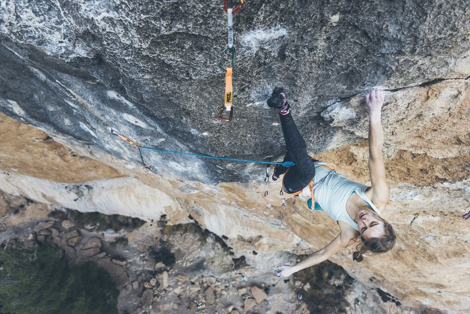 """Margo Hayes (20) climbing in Spain. Hayes became the first woman to climb a consensus 5.15a """"La Rambla"""" in 2017. Photo Credit: Greg Mionske"""