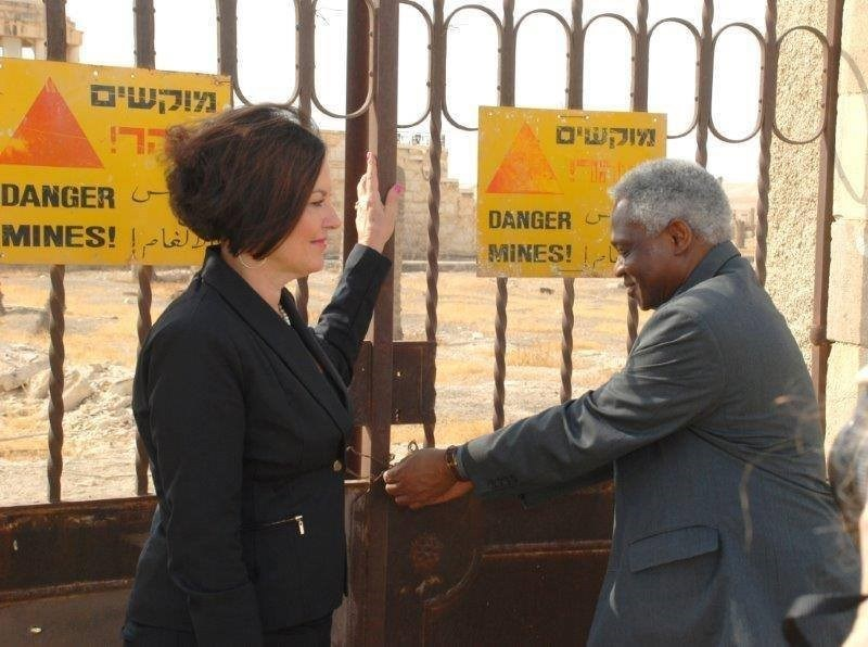 Heidi Kuhn, CEO, Roots of Peace and Cardinal Peter Turkson, The Vatican--November 2014. Forbidden Minefield Gates of Qasr-al-Yahud, Baptismal Site of Jesus.