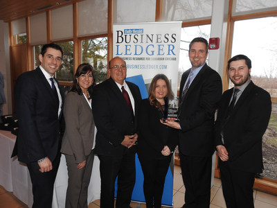 Combined Insurance representatives accept Business Ledger award. From left to right: John Capra, Market Director; Sherry Anaya, Vice President, Claims; Dean Demos, Chief Information Officer; Kim Watkins, Sales Project Manager; Dan Dykstra, Director, Digital Marketing; Jeff Kelleher, Talent Management Specialist