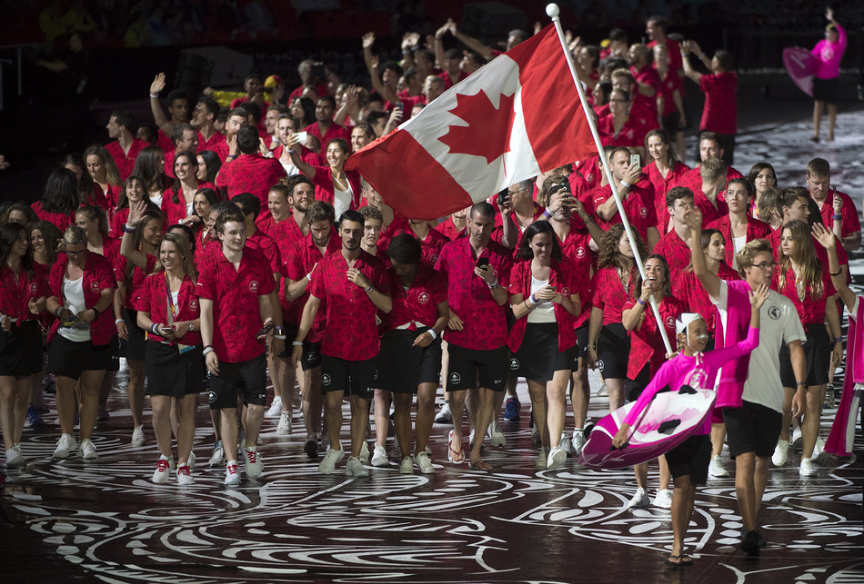 Team Canada enters the Stadium at the Opening Ceremony of the 2018 Commonwealth Games in Gold Coast, Australia, led by Commonwealth and Olympic medalist Meaghan Benfeito. (CNW Group/Commonwealth Games Association of Canada)