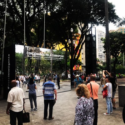 Huge mirror in Sao Paulo shows people condemned by corruption in action created by Momentum for Estadao