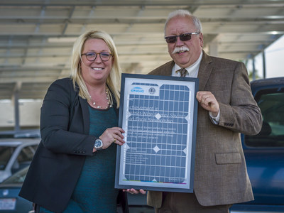 ENGIE Services U.S. Vice President Courtney Jenkins and Escalon Unified School District Superintendent Ron Costa commemorate the beginning of Escalon Unified's new, comprehensive clean energy program with ENGIE.