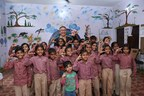 Mr. Kazutada Kobayashi, CEO, and President with children in Maheshwari Village (PRNewsfoto/Canon India Pvt. Ltd.)
