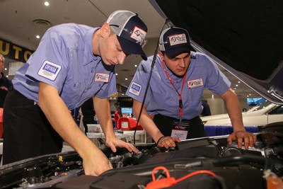 National Automotive Technology Competition Winners Andrew Stuart (left) and Evan Sennefelder under the hood at the 2018 National Automotive Technology Competition.