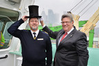 "Earlier today, PortsToronto's Harbour Master Emeritus Angus Armstrong ""crowned"" Mykhaylo Omelchuk at the 157th annual Beaver Hat Ceremony with the antique silk and beaver top hat first presented in the spring of 1861. (CNW Group/PortsToronto)"